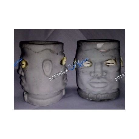 """<p>Two face elegua or echu head in cement 4""""H x 3""""W x 2 3/4"""" D X 2 1/4 hole each face is in the oposet side of the cement.</p>"""